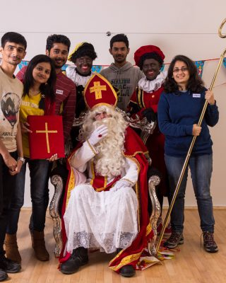 Intercultural Evening Sinterklaas, taking a picture with the old man.