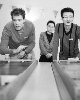 Intercultural Evening, playing shuffle-board, a typical Dutch game